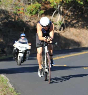 Austin Mitchel on his bicycle during a triathlon
